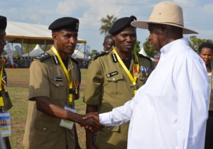 President Yoweri Museveni greeting one of the award receipients from the Uganda Police during celebrations to mark International Labor day on May 1 2019 in Agago District (PHOTO: Uganda Police)