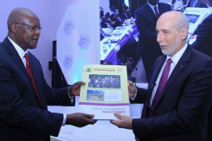 Justice Bart Katureebe handing over a copy of the 2018 - 2019 JLOS Performance Report to Amb. Atilio Pacifici Chairperson of the JLOS Development Partners Group at the 24th Annual JLOS Review on 12th November 2019 (PHOTO: JLOS)