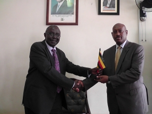 Hon. Peter Nyombi (left) and Hon. Fredrick Ruhindi (right) during the handover ceremony of the Office of the Attorney General on March 12 2015 at the Ministry of Justice and Constitutional Affairs. (PHOTO: JLOS/Edgar Kuhimbisa)