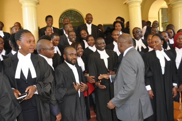 The Chief Registrar, H.W Gadenya Paul Wolimbwa with the recently enrolled advocates at the High Court in Kampala (Source: Judiciary)