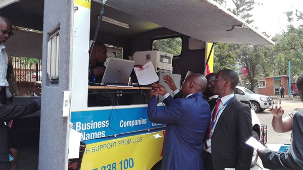 A URSB official demonstrating how the mobile registration truck works (PHOTO: observer.ug)