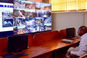 President Museveni at the commissioning of the CCTV Project at the command centre at Nateete Police Station (PHOTO: Uganda Police)