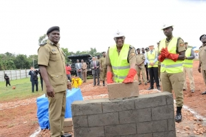 Inspector General of Police J.M Okoth Ochola (middle) launching the National Command and ICT Research and Innovation Centre in Naguru, Kampala (Source: Uganda Police)