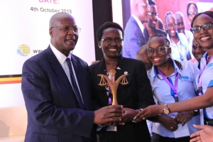A team from URSB receiving a JLOS Recognition Award from the Chief Justice Hon. Bart M. Katurebe at the 23rd Annual JLOS Review held on October 4 2018 at the Law Development Centre in Kampala (PHOTO: JLOS)