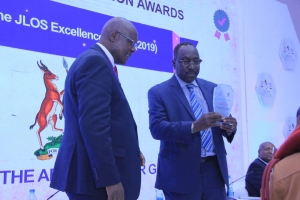 The Solicitor General Mr. Francis Atoke receiving the 2019 JLOS Excellence Award on behalf of the Office of the Administrator General (Ministry of Justice and Constitutional Affairs) during the 2019 JLOS Recognition Awards Ceremony on 12th November 2019 (PHOTO: JLOS)
