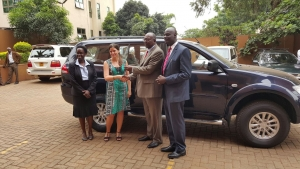 Ms. Simone Ungersboeck, from the Austrian Development Cooperation (ADC) handing over the vehicle to Justice David Wangutusi, the Chairperson ADR Project Advisory Board on December 14, 2015 at the Commercial Court building in Kampala. (PHOTO: JLOS/Rachel Odoi-Musoke)