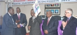 The Ag. Chief Justice, Justice Stephen B.K Kavuma (L)  handing over the JLOS Annual Peformance Report (2012/13) to the Chair of the JLOS Development Partners Group, H.E Dan Frederiksen during the 18th Annual JLOS Review on October 8, 2013. (PHOTO: JLOS MEDIA