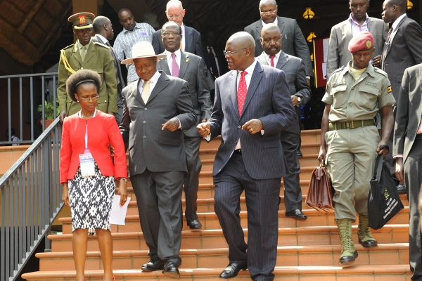 H.E the president with Justice Centres National Coordinator Ms Christine B. Nsubuga (left) and the Chief Justice (right) after opening the legal aid conference on August 10, 2015 (PHOTO: JLOS)